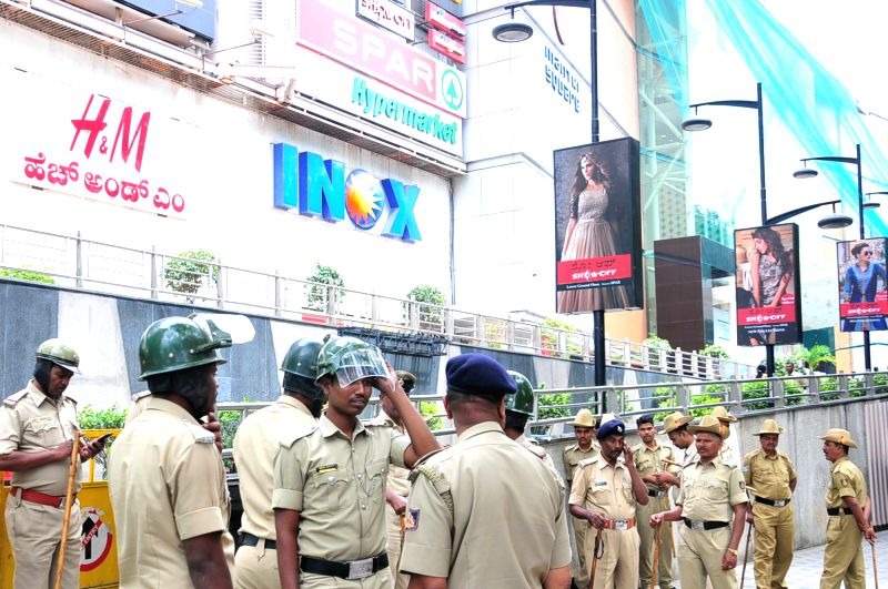 "Security forces deployed outside a mall ahead of the screening of Rajinikanth starrer Tamil film ""Kaala""amid vociferous protests by pro-Kannada activists against his remarks on ..."