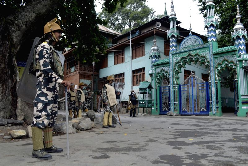 Security forces keep a strict vigil as authorities clamp curfew and restrictions amid protest shutdown called by separatists at Khanpora of Baramulla district in Jammu and Kashmir, on Aug ...