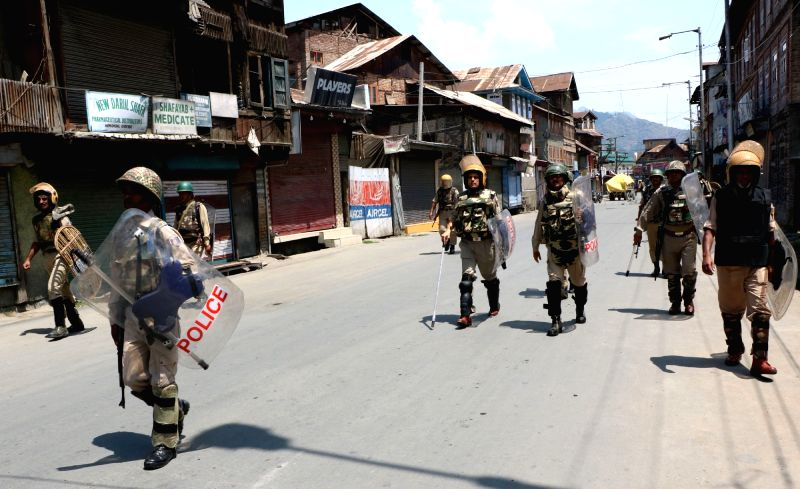 Security forces keep a strict vigil as curfew and separatists-called shutdown marred life across the valley for the 14th day running on July 22, 2016.