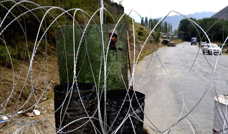 Security forces keep strict vigil in Baramulla as curfew continues in Kashmir valley on July 17, 2016.
