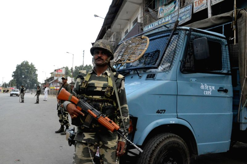 Security forces keep strict vigil in Qazigund of Kulgam district as curfew continues in Kashmir valley on July 19, 2016.