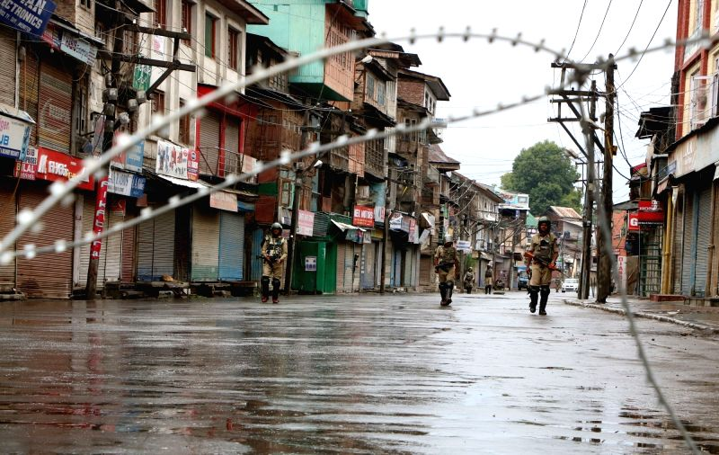 Security forces keep strict vigil in Srinagar as curfew continues in Kashmir valley on July 18, 2016.