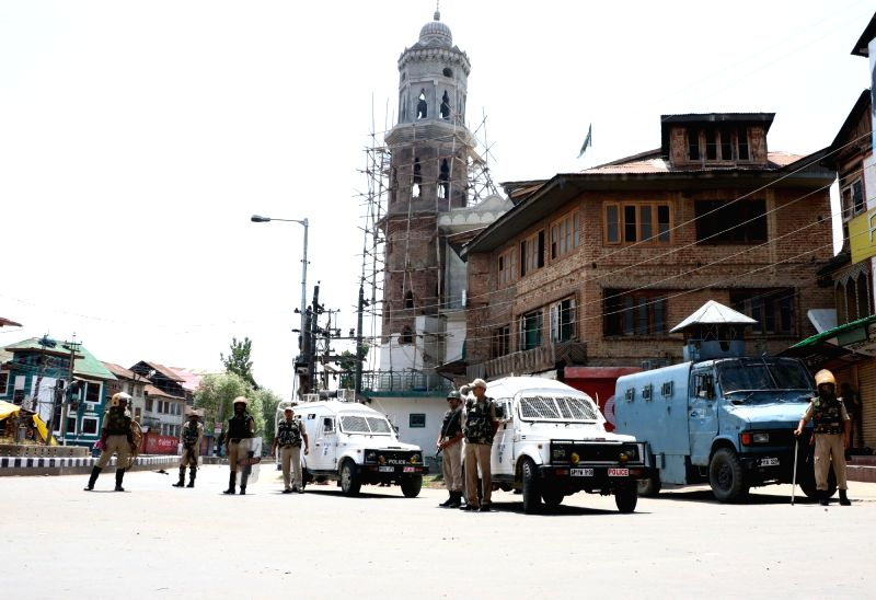 Security forces keep strict vigil in Srinagar as curfew continues in Kashmir valley on July 19, 2016.