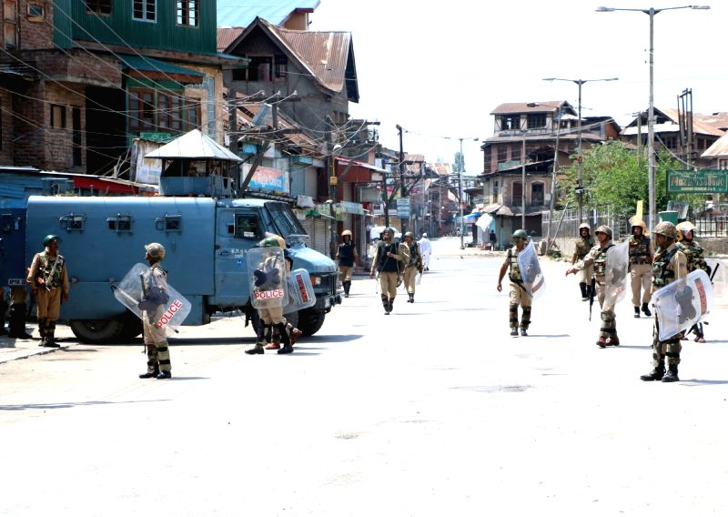 Security forces keep strict vigil in Srinagar as curfew continues in Kashmir valley on July 20, 2016.