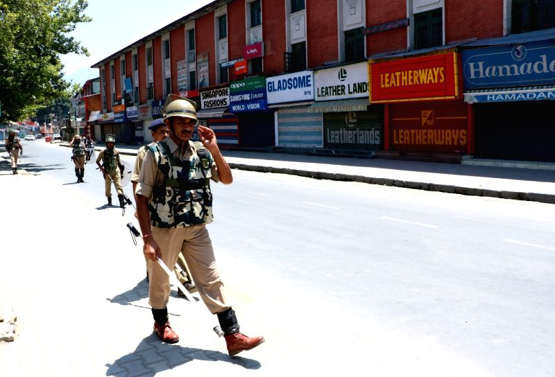 Security forces keep strict vigil in Srinagar as curfew continues in Kashmir valley on July 21, 2016.