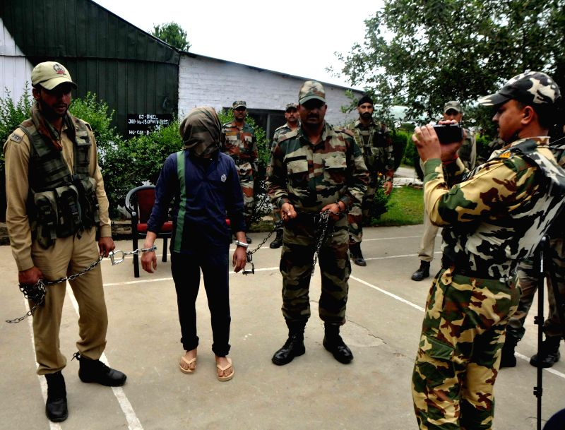 Security forces present before press one of the top commanders of Lashkar- e-Taiba (LeT) after arresting him from a hideout in South Kashmir's Kulgam district on June 20, 2014.
