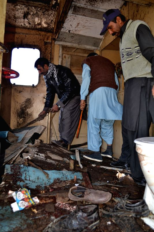 Security officials examine a damaged train compartment at a blast site in Mastung district of Balochistan, Pakistan, Nov. 1, 2015. At least four people were killed ...