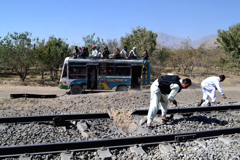 Security officials examine damaged railway tracks at a blast site in Mastung district of Balochistan, Pakistan, Nov. 1, 2015. At least four people were killed and 10 ...