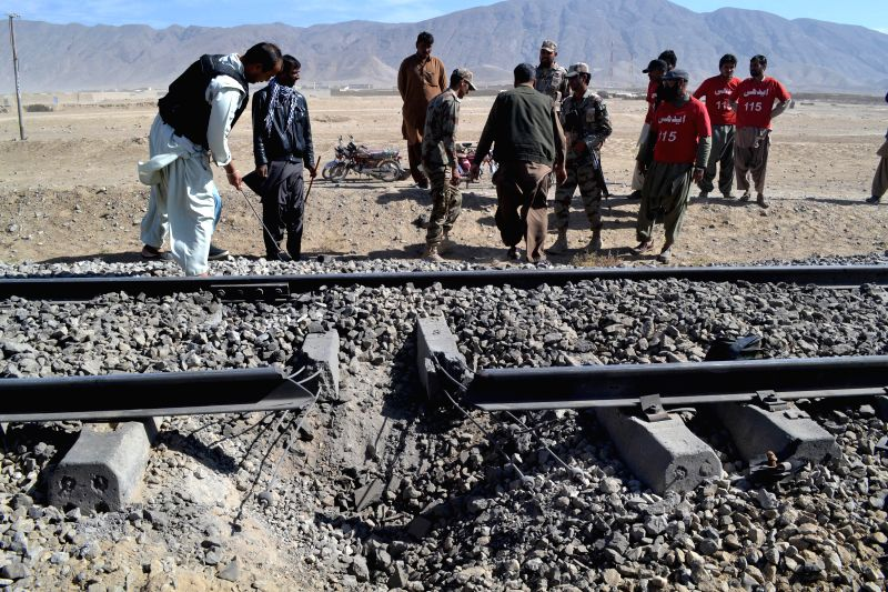 Security officials examine damaged railway tracks at the blast site in Mastung district of Balochistan, Pakistan, Nov. 1, 2015. At least four people were killed and ...