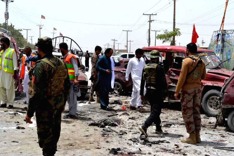 : Security officials inspect the blast site in southwest Pakistan's Quetta, on July 25, 2018. At least 29 people, including three policemen, were killed and ...