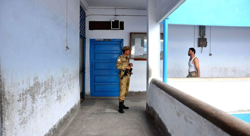 Security personnel a polling station ahead of 9th phase of 2014 Lok Sabha Elections in Kolkata on May 11, 2014.