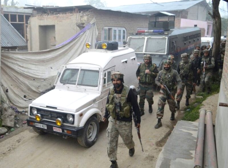 Security personnel at the site of encounter with Hizbul Mujahideen outfit militants in Pulwama of Jammu and Kashmir on on May 7, 2016. Three Hizbul Mujahideen outfit militants were killed in ...