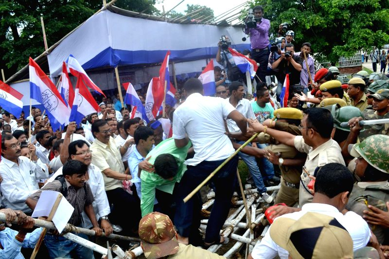 Security personnel charge batons on Asom Gana Parishad (AGP) workers demonstrating against expulsion of illegal Bangladeshi Migrants at Dispur Last Gate  in Guwahati on Aug 4, 2014.