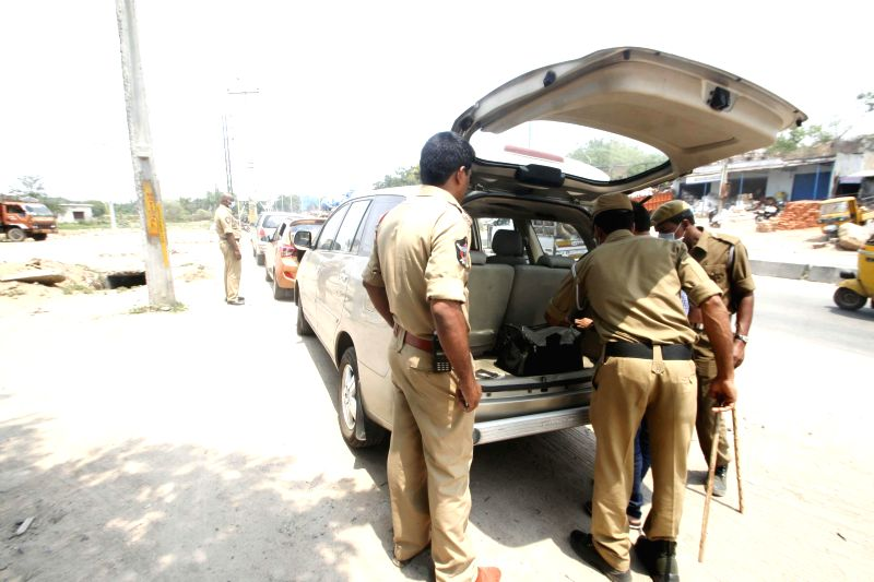Security personnel check a car ahead of the first phase of Andhra Pradesh Legislative Assembly Elections on April 27, 2014.