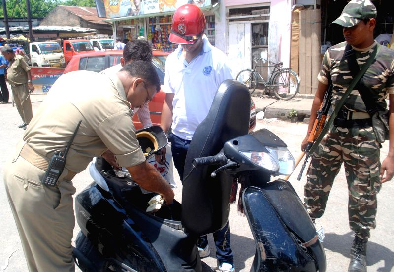 Security personnel checking vehicles ahead of Independence day celebration in Guwahati on Aug. 9, 2014.