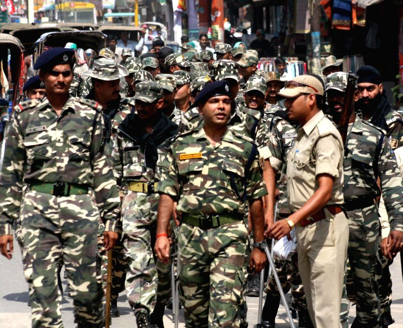 Security personnel conduct a flag march a day ahead of 9th phase of 2014 Lok Sabha Elections in Varanasi on May 11, 2014.