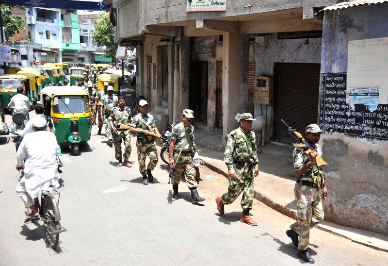 Security personnel conduct a flag march ahead of the the seventh phase of 2014 Lok Sabha polls scheduled to be held on 30th April, in Ahmedabad on April 27, 2014.