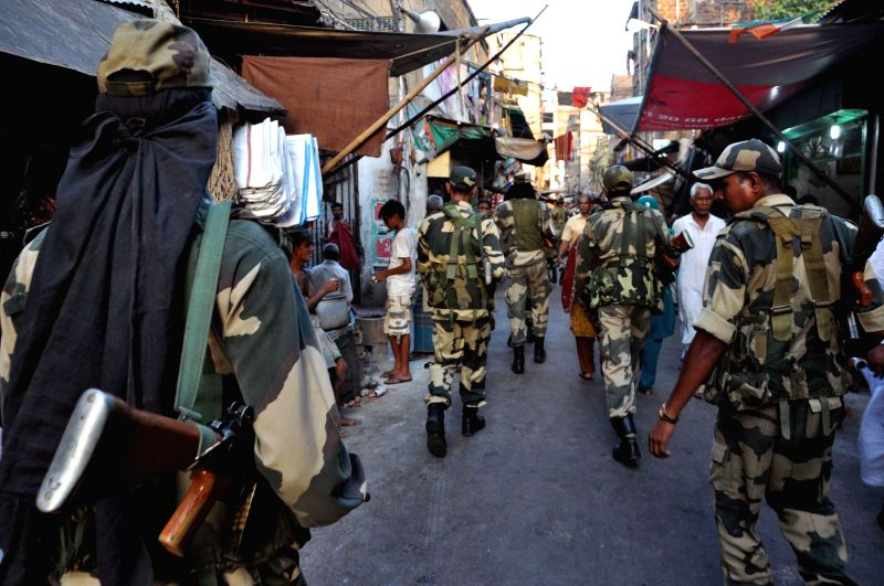 Security personnel conduct a flag march ahead of the ninth and the last phase of 2014 Lok Sabha Elections in Kolkata on May 9, 2014.