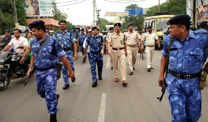 Security personnel conduct flag march in Patna ahead of Eid on June 14, 2018.