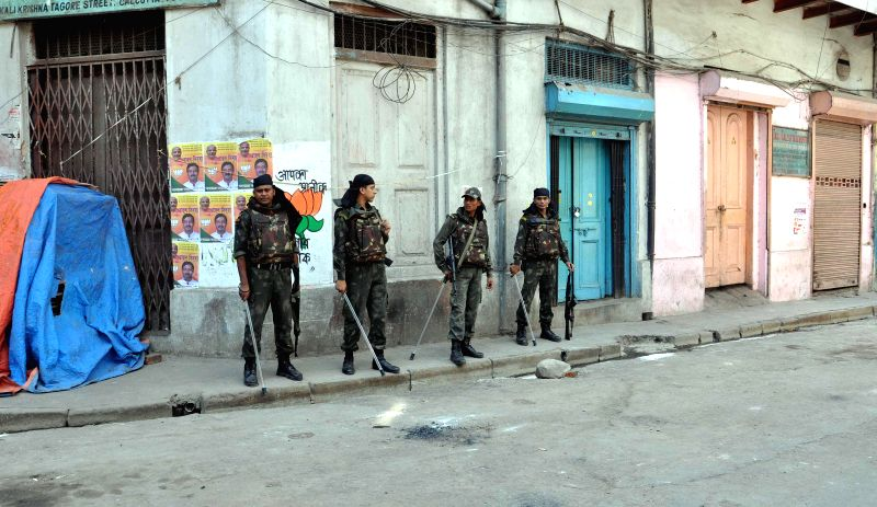 Security personnel deployed after crude bombs were found in Posta area of Kolkata's Burrabazar during the ninth phase of 2014 Lok Sabha Polls in Kolkata on May 12, 2014.