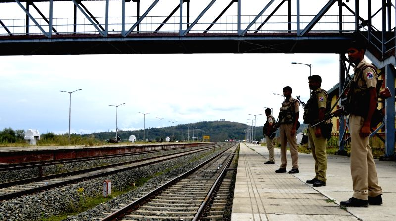 Security personnel deployed at Baramulla Railway station as rail services were suspended as authorities continued curfew and restrictions in parts of Kashmir for the 31st consecutive day ...