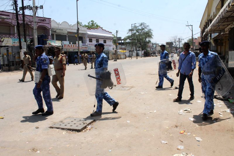 Security personnel deployed in Kishanbagh area of Hyderabad after a clash between two groups on May 15, 2014.