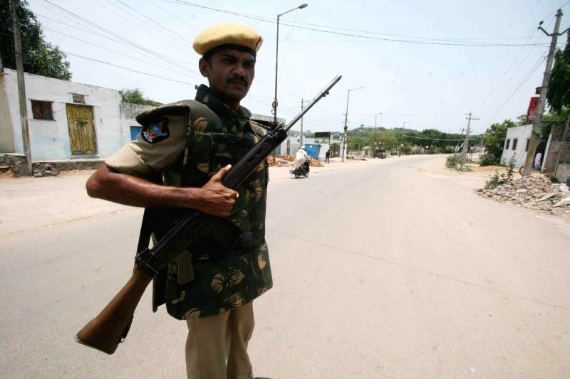 Security personnel deployed in Kishanbagh as a curfew has been imposed in the area after two groups clashed on 14th May, 2014, in Hyderabad on May 17, 2014.