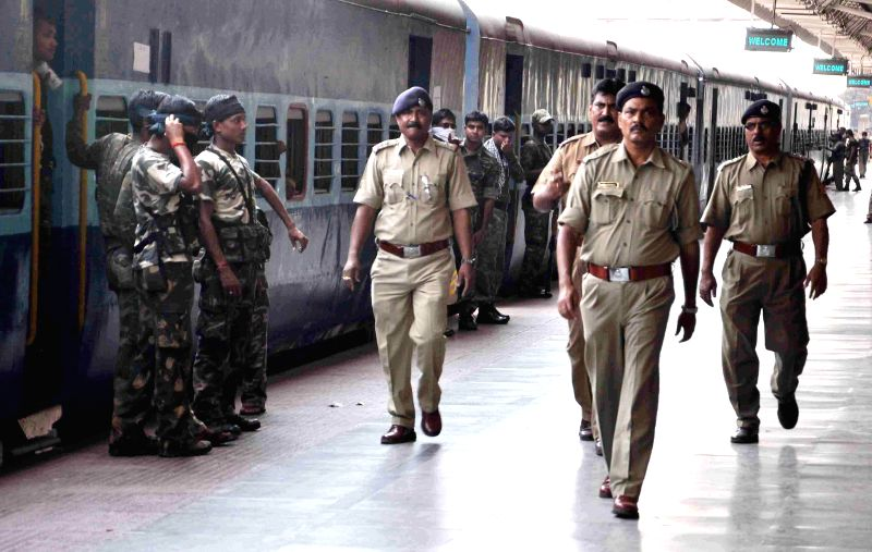 Security personnel deployed on 2014 Lok Sabha Election duty at Howrah station as they leave for their respective destinations, in Howrah on April 14, 2014.
