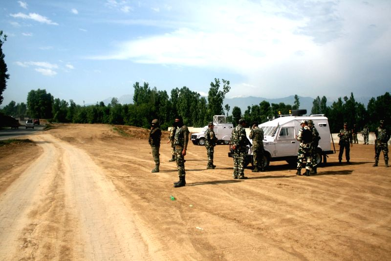 Security personnel deployed on  Srinagar-Jammu national highway after a civilian was injured in a militant attack on security forces on the highway on June 10, 2017.