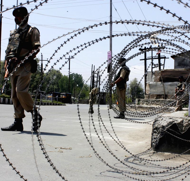 Security personnel deployed on the streets of Srinagar as a curfew has been imposed in some parts of the city to maintain law and order following a youth's killing in firing by security forces, on ...