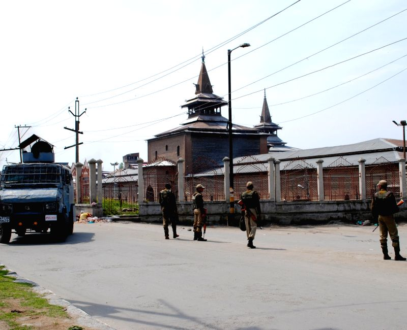 Security personnel deployed on the streets of Srinagar as a curfew which was imposed in some parts of the city to maintain law and order following a youth's killing in firing by security forces ...