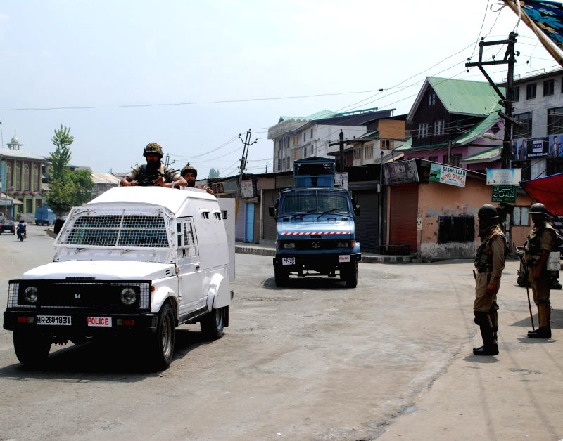 Security personnel deployed on the streets of Srinagar as restrictions were imposed in Rainawari, Khanyar, Nowhatta, M.R. Gunj and Safa Kadal areas of the city to prevent a rally called by the ...