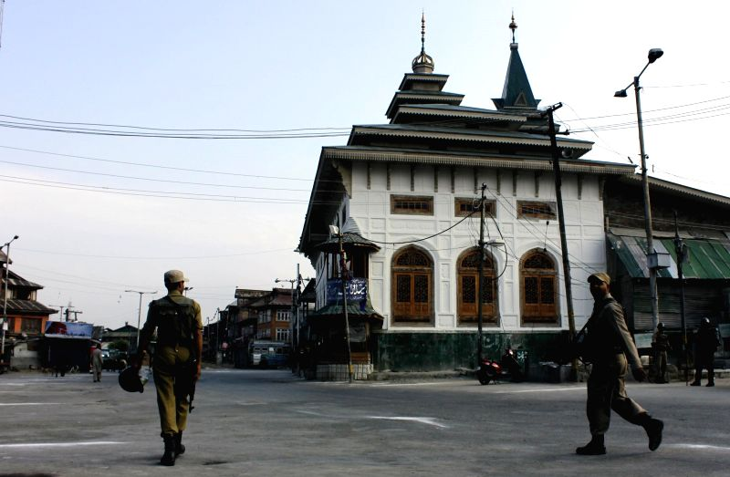 Security personnel deployed on the streets of Srinagar as authorities have imposed restrictions on the movement of public and transport in some areas of the city in light of proposed separatist ...