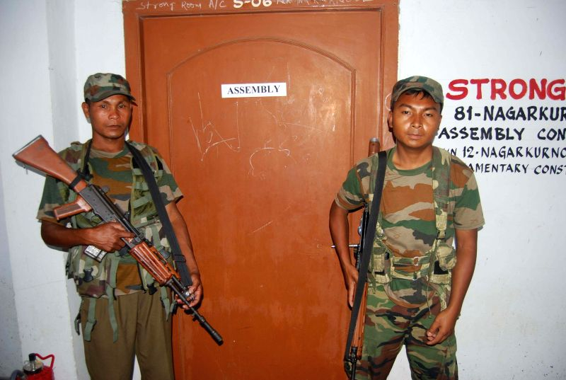 Security personnel deployed outside a strong room in Telangana on May 2, 2014.