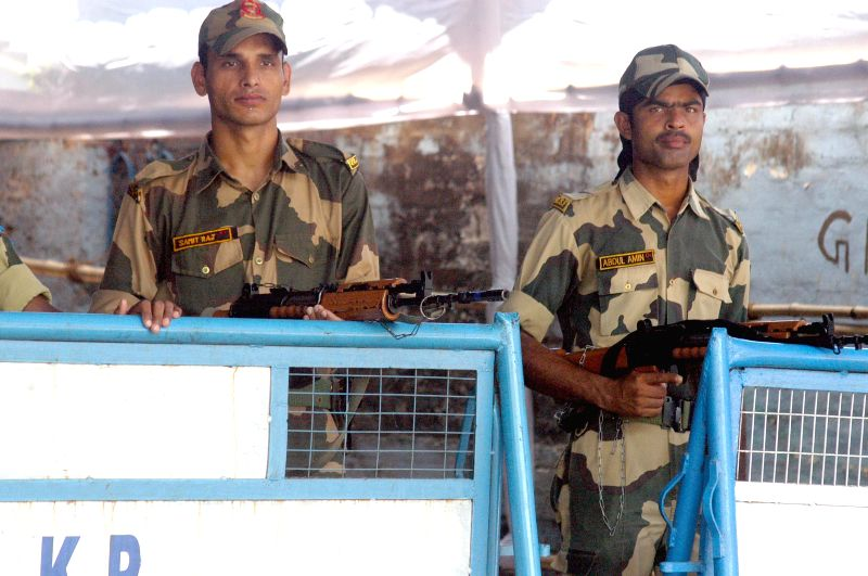 Security personnel deployed outside a strong room where Electronic Voting Machines (EVMs) are stored after 2014 Lok Sabha Polls in Kolkata on May 13, 2014.