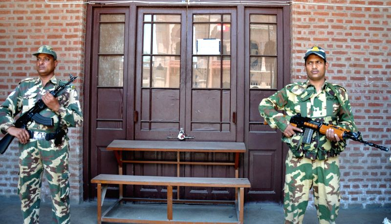 Security personnel deployed outside a strong room in Amritsar on May 15, 2014.