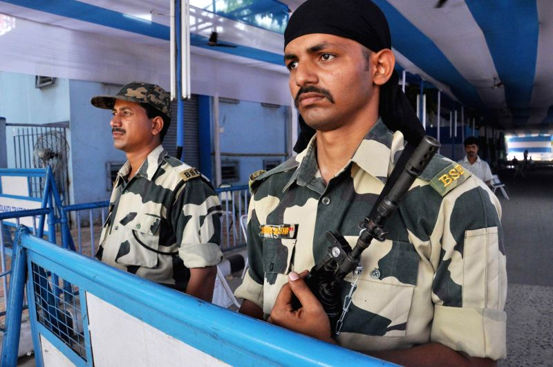 Security personnel deployed outside a strong room where Electronic Voting Machines (EVMs) are stored after 2014 Lok Sabha Polls in Kolkata on May 15, 2014.