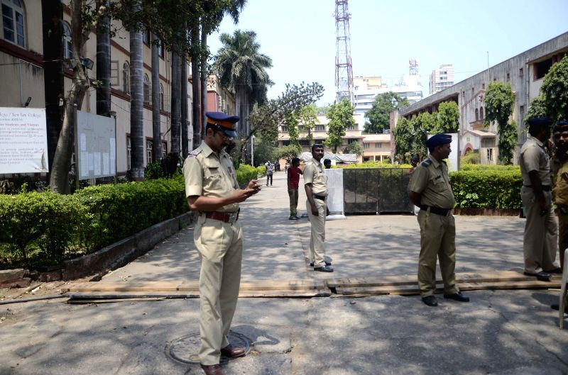 Security personnel deployed outside D.G. Ruparel College where a a strong room is set-up, in Mumbai on April 25, 2014.