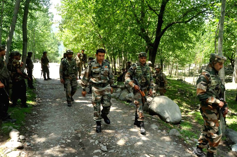 Security personnel during an encounter with militants at Aaripal Village in Tral Pulwama district of Jammu and Kashmir on July 5, 2014.