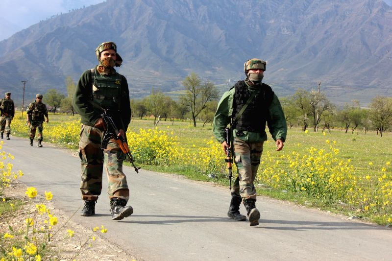 Security personnel during an operation after a militant attack on the residence of National Conference (NC) youth leader Yawar Masoodi in which two policemen were killed  at Khrew in Pulwama, 35 km ..