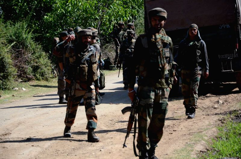 Security personnel during search operations after two militants and a soldier were killed in a gunfight in Jammu and Kashmir's Bandipora district on June 14, 2018.