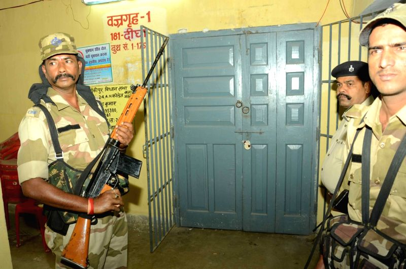 Security personnel guard a strong room setup at a Patna College on Oct 29, 2015.