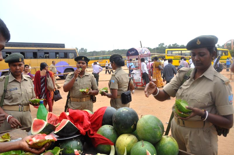 Security personnel have fruits before leaving for their respective polling booths ahead of the 5th phase of 2014 Lok Sabha Elections from a polling station in Ranchi on April 16, 2014. (Photo : IANS)