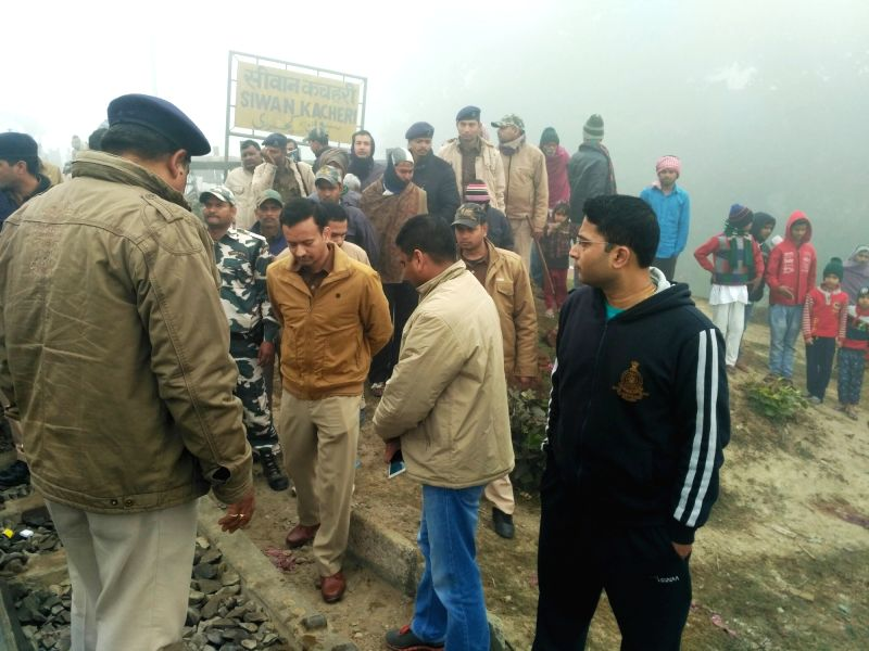Security personnel inspect at the accident spot in Bihar's Siwan where a passenger train ran over five persons, who were crossing railway tracks over a narrow rail bridge in the early hours, ...