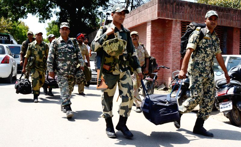Security personnel leave for their respective polling booths on the eve of the 7th phase of 2014 lok Sabha Polls from an EVM and election material distribution centre in Amritsar  on April 29, 2014.