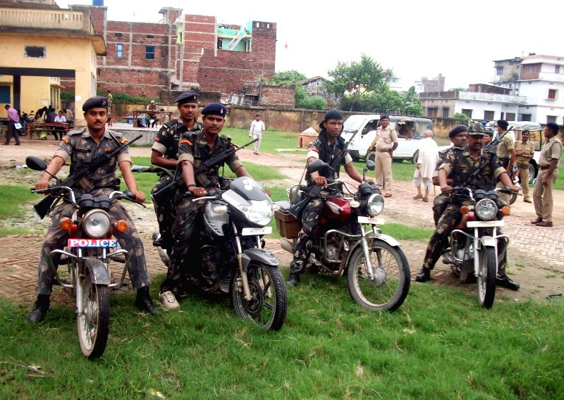 Security personnel on patrol duty as by-elections for Saran Lok Sabha constituency are being held in Saran district of Bihar on Aug 21, 2014.