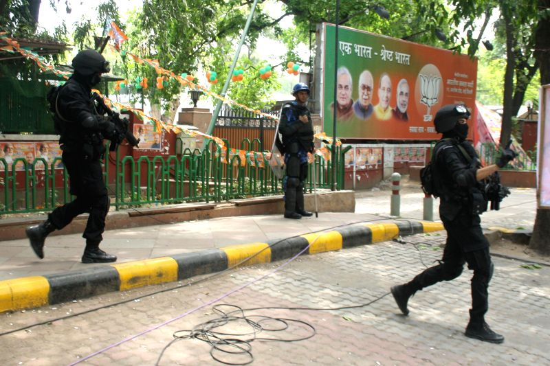 Security personnel outside BJP headquarters in New Delhi on May 17, 2014.