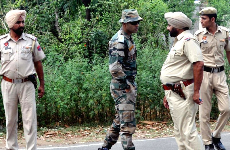 Security personnel participate in a massive search operation launched in Pathankot district of Punjab following seizure of a suspicious bag that contained three army uniforms on May 29, ...