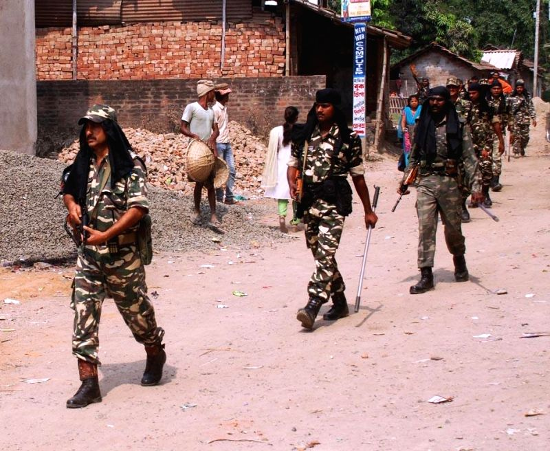 Security personnel patrol a border village on the eve of Independence Day in West Bengal's Malda district on Aug 14, 2014.