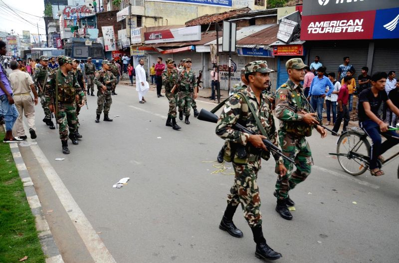 Security personnel patrol the streets of Ranchi following clashes between two groups, on June 10, 2018.